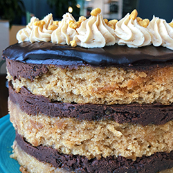 <strong>Reverse Chocolate Peanut Butter Cake</strong> <br>old fashioned peanut butter cake . chocolate buttercream . ganache . peanut butter buttercream . peanut brittle crunch