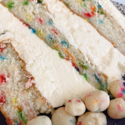 <strong>Funfetti Cake</strong> <br>rainbow sprinkle butter cake with funfetti buttercream icing